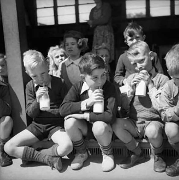 1960s-school-boys-in-shorts-drinking-milk-from-the-bottle.jpg